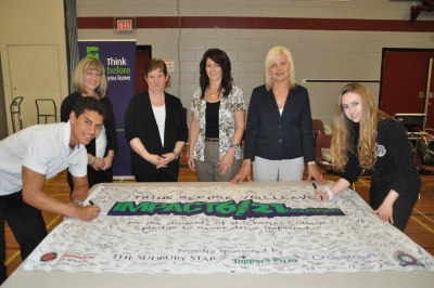 Taking the Pledge for Caitlin, Jazmine and Steven at St. Charles College