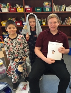 St. Charles College Ugly Sweaters Team Up with Holy Trinity Grade One students in PJ's