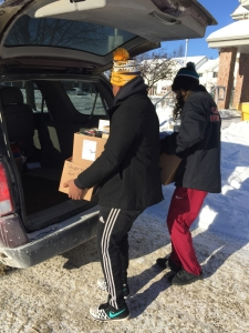 Leadership students at St. Charles College delivering baskets again this season