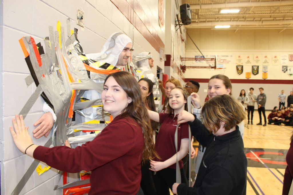 St. Charles College Students Duct Tape VP's to the Wall in Support of NCF