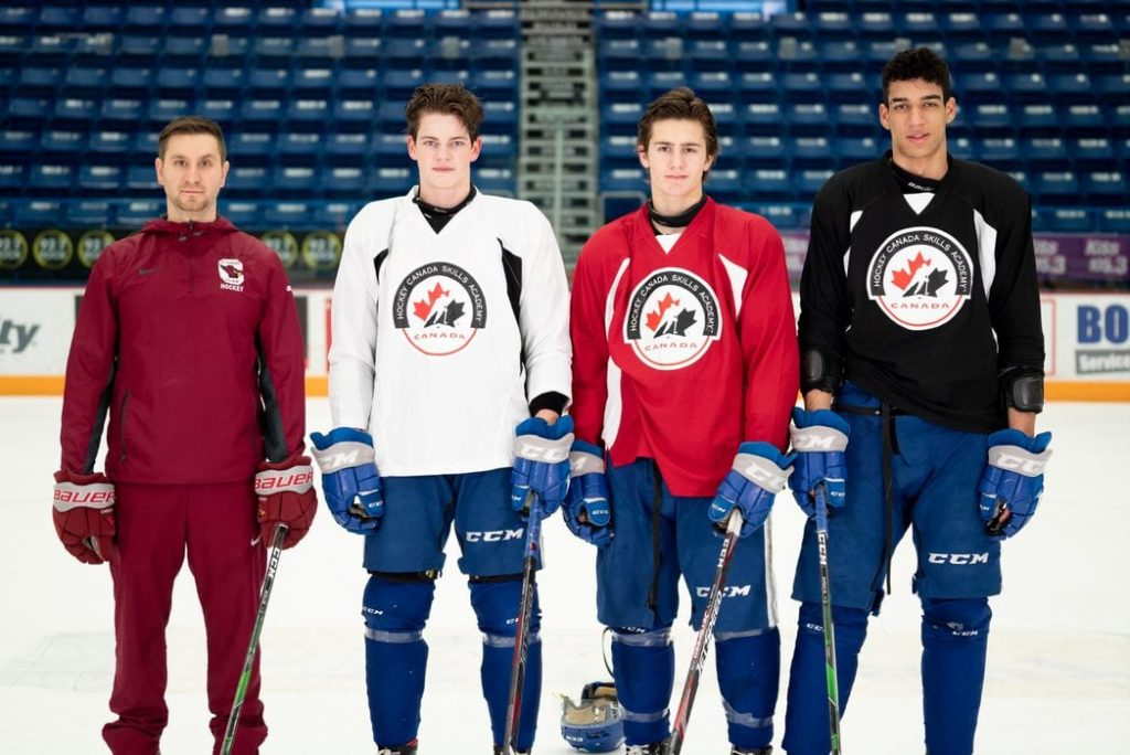 Athletic Director and Hockey Canada Skills Academy Lead Darren Michelutti with Jack Thompson, Chase Stillman and Quinton Byfield.
